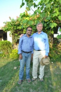 Nandan standing in a garden with Richard Dawkins